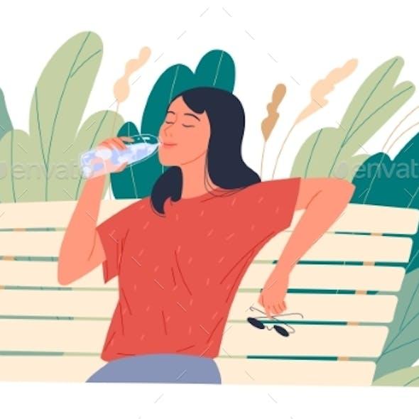 Girl Enjoying Drinking Water While Sitting