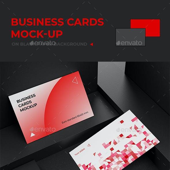 Business cards mock-up on black paper background