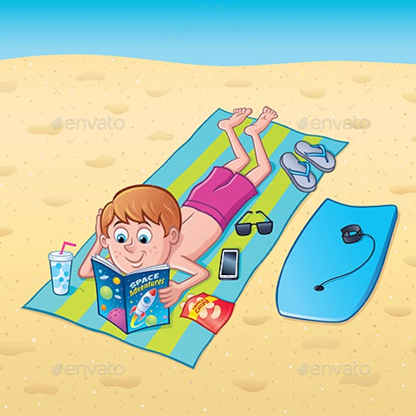 Boy Reading On A Towel At The Beach