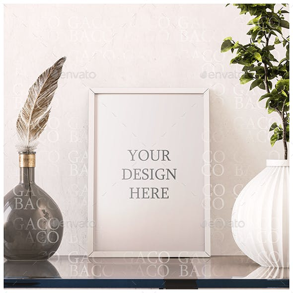 A4 Vertical Print with White Frame on White Wall and Glass Desk with Green Plant