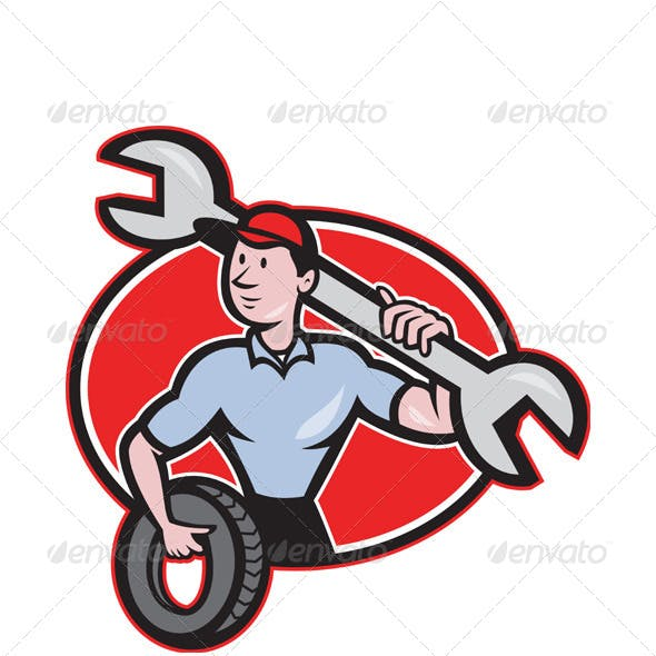 Mechanic With Spanner and Tire Wheel
