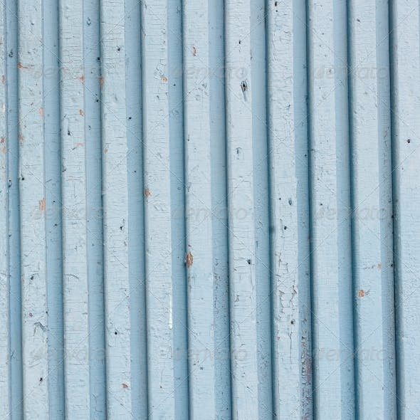 blue old painted wooden fence, naturally weathered
