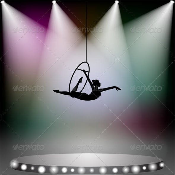 Aerial Acrobat Woman on Circus Stage with Spotlight