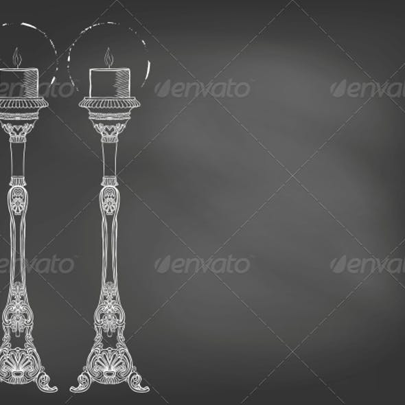 Two Highly Ornamental Candles on Blackboard