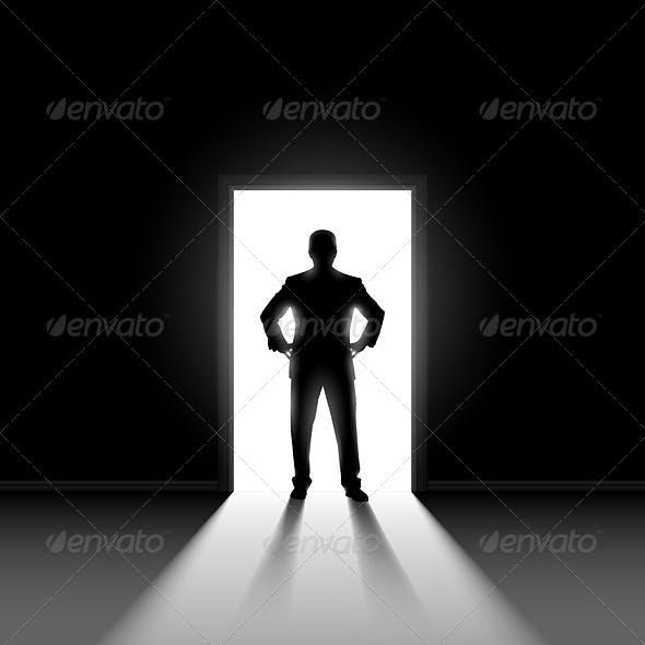 Silhouette of Man Standing in Doorway.