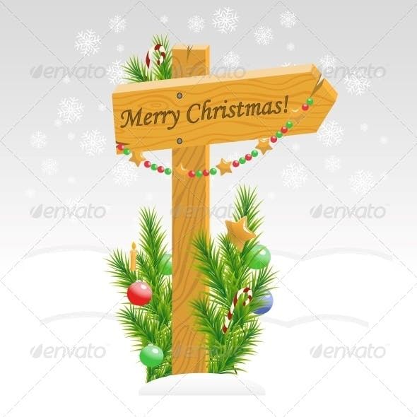 Wooden Arrow with Christmas Toys and Text