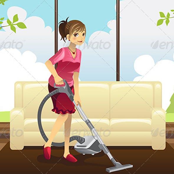 Housewife Vacuuming Carpet