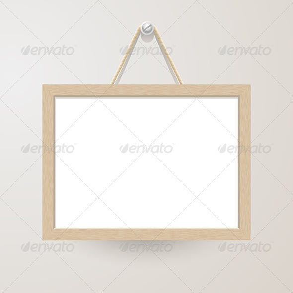 White Board Hanging on a Nail