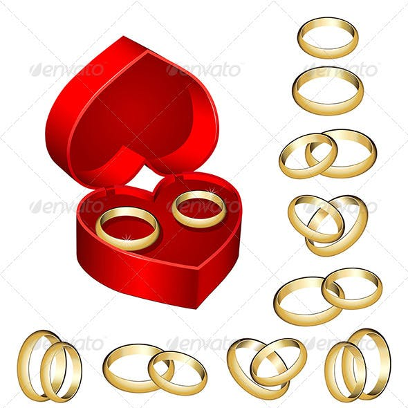 Set of gold wedding rings with heart-shaped box