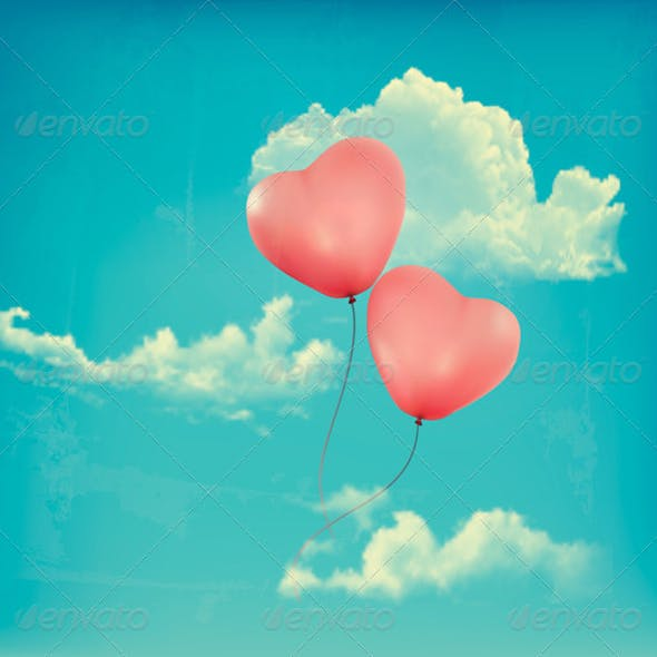 Valentine Heart-Shaped Baloons in a Blue Sky
