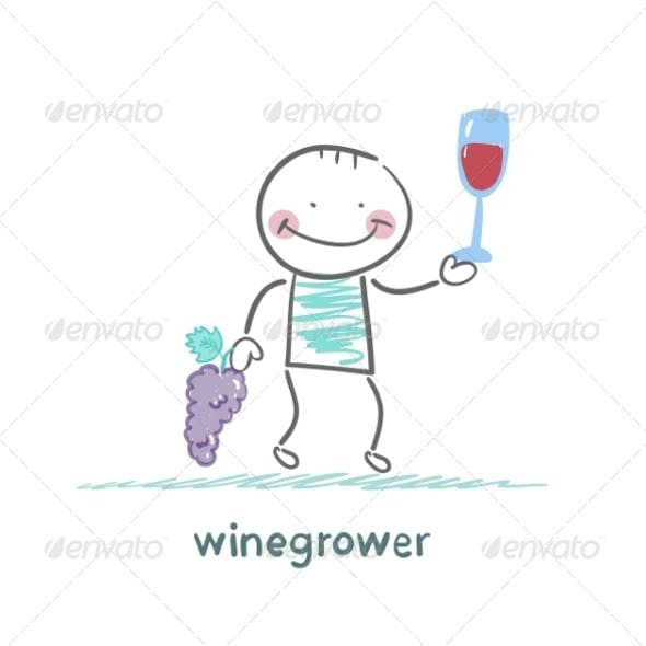 Winegrower Holds Grapes and Wine Glass