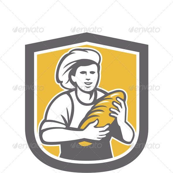 Female Baker Holding Bread Loaf Shield