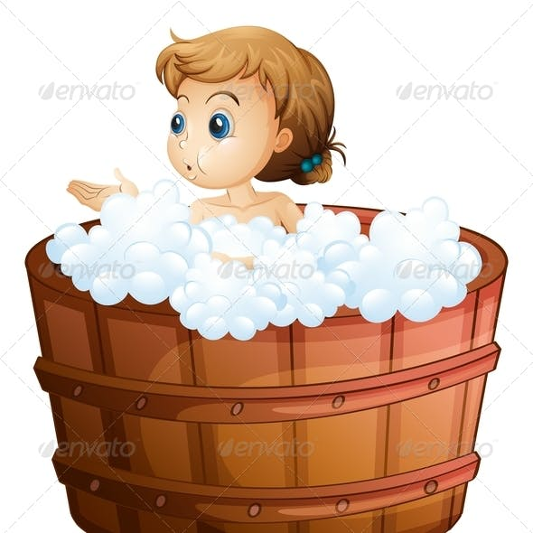A young girl taking a bath