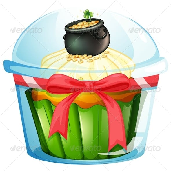 A cupcake with a pot of coins
