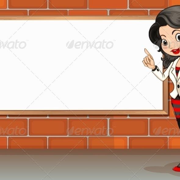Lady standing beside empty signboard