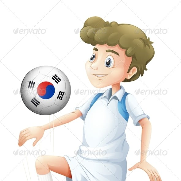 Boy Playing with South Korean Soccer Ball