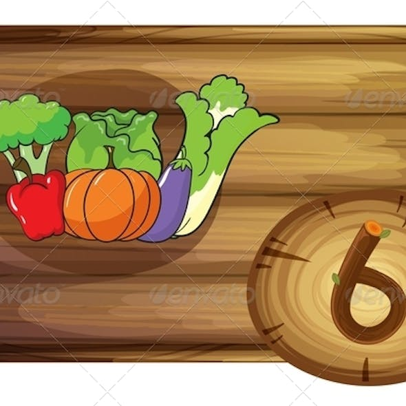 Wooden frame with six vegetables