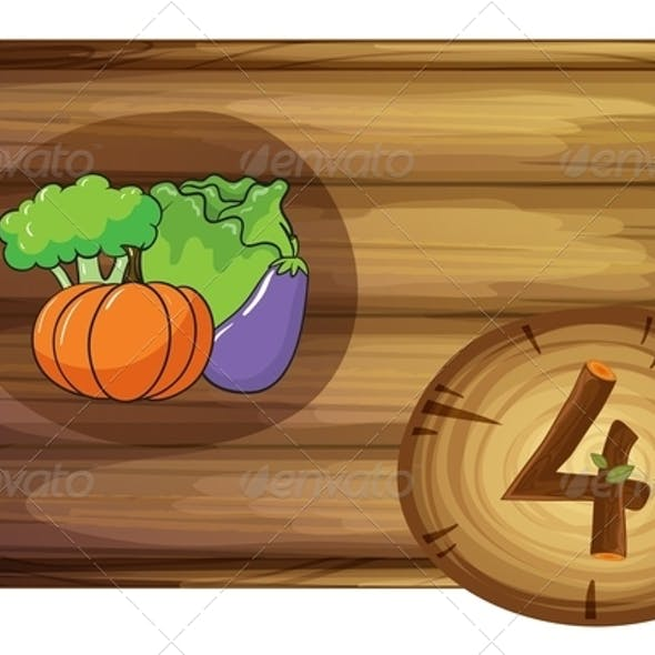 Wooden frame with four vegetables