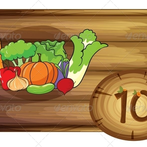 Wooden frame with ten vegetables