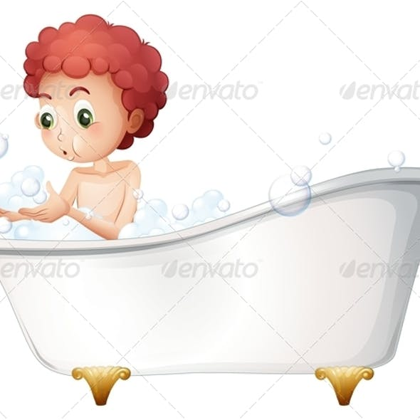 Boy playing in the bath