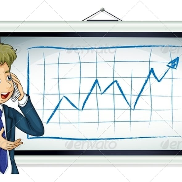 Businessman in front of chart with phone