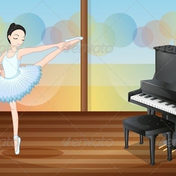 Ballerina Dancing Near the Piano Inside a Studio