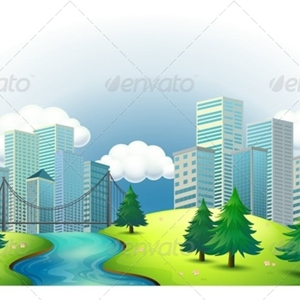 Tall Buildings on an Island with a River and Pines