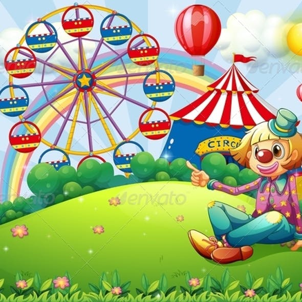 A Clown at the Hilltop with a Carnival and a Rainbow