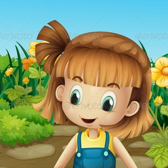 Little Girl in the Garden with Blooming Flowers