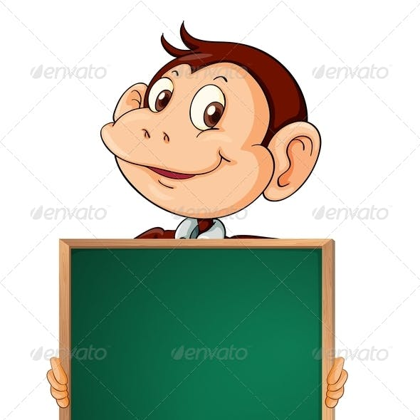 A Male Monkey Holding an Empty Blackboard
