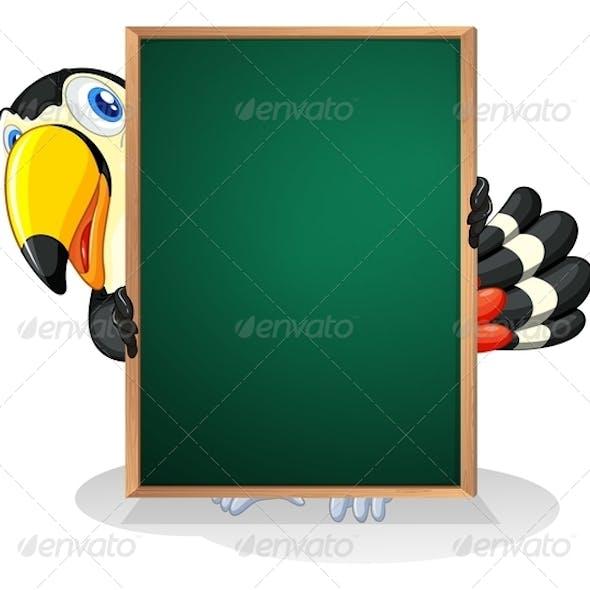 A Toucan holding an empty framed board